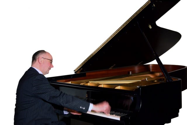 Fergus Black playing a grand piano