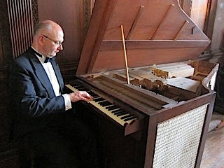Fergus Black at the organ of Burghley House